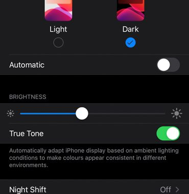 Activate Dark Mode in Settings in your iPhone